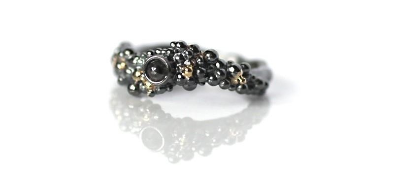 Srebrno-złoty pierścionek z czarnym diamentem