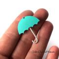 Ręcznie robiony pin parasolka