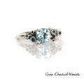 Srebrny pierścieńz niebieskimi topazami, szafirami i kuleczkami