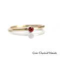 Złoty pierścionek z czerwonym szafirem